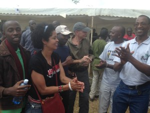 """Paula Kahumbu, U.S. ambassador Robert Godec, and Josphat Ngonyo (far right), with other participants in the """"Global March for Elephants & Rhinos"""" on October 3, 2014 in Nairobi, Kenya. Kenyan tourism has prospered since prohibiting trophy hunting since 1977."""