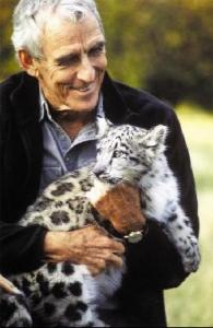 Peter Mattheissen with snow leopard (from book promotional poster)