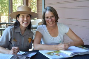 Park ranger Yenyen Chan and author Annette Bay Pimentel signing Mountain Chef at Yosemite.