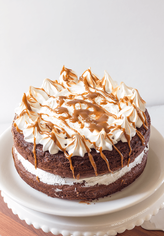 Meringue Topped Chocolate Fudge Cake with Salted Caramel Sauce | Annie's Noms - This is no ordinary chocolate fudge cake, it's a showstopper! A rich, soft cake is perfectly complimented by sweet, glossy peaks of meringue and drizzled with homemade sticky, salted caramel sauce. Chocolatey and with that perfect contrast between sweet and salty, what is there not to love?