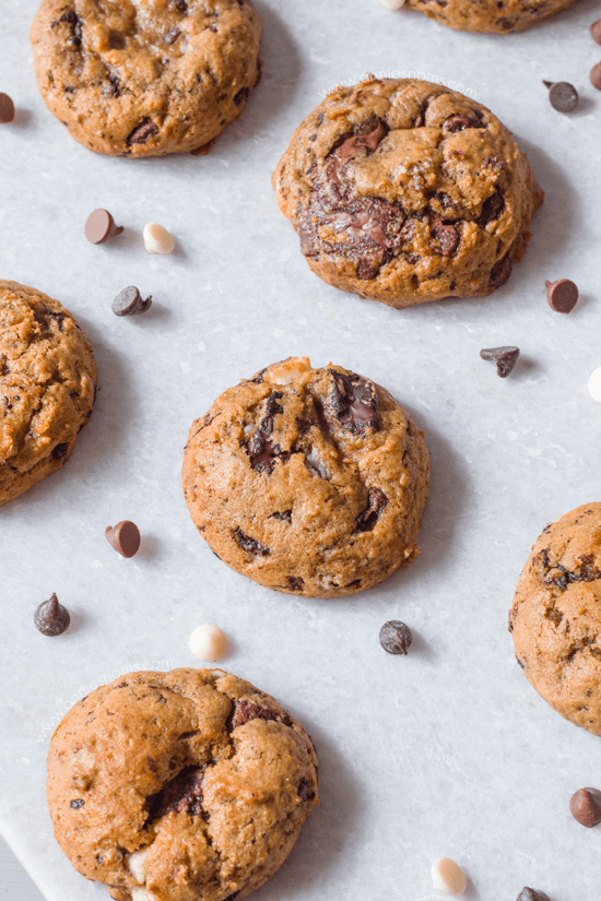 Pumpkin Triple Chocolate Chip Cookies | Annie's Noms - Say goodbye to cakey pumpkin cookies with these Pumpkin Triple Chocolate Chip Cookies! Soft, chewy, lightly spiced and with white, milk AND dark chocolate; these are the only pumpkin cookie recipe you need!
