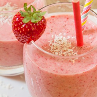 This quick and flavour packed Strawberry Coconut Smoothie is the perfect pick me up. With coconut milk, fresh, juicy strawberries, and a frozen banana base, it's super smooth, creamy and ready in 5 minutes!