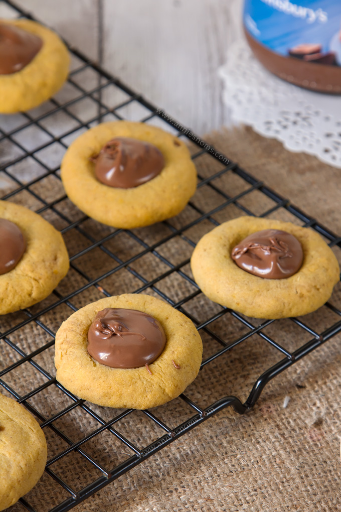 These Pumpkin Nutella Thumbprint Cookies are little bites of heaven. Spiced cookies, baked until slightly crisp, with gooey, rich Nutella spooned into the middle make these cookies simply irresistible!