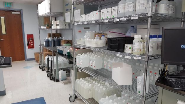 shelf full of laboratory reagents