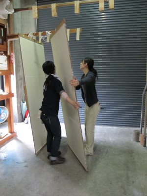 the young women moved the heavy drying boards