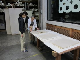 inspecting the finished paper