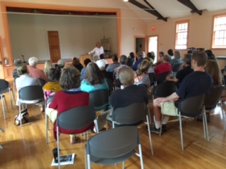 Nancy Aronie speaking to a full house at the Old Town Hall in Aquinnah.