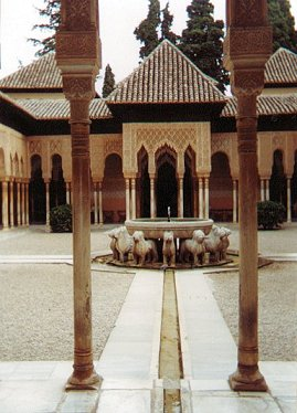 Granada Alhambra is an historical structure with a central courtyard.