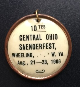 Original celluloid badge.