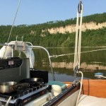 """Temporary """"galley"""" - a Coleman camping stove on the lazarette."""
