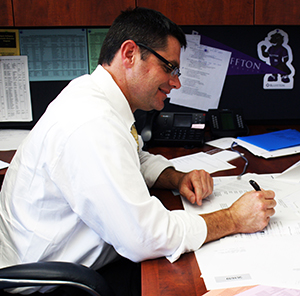 Principal Ryan McClure prepares for the 2013-14 school year. McClure officially began his tenure at UAHS Aug. 1.