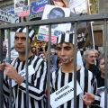 Some protesters were dressed in black-and-white striped prisoner uniforms with the names of current prisoners pinned to their shirts.