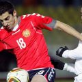 Julian de Guzman, left, of Canada fights for the ball with Henrikh Mkhitaryan of Armenia during their friendly in Cyprus on Feb. 29. (Petros Karadjias/Associated Press)