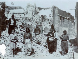 Armenian survivors of the Adana massacres at the ruins of their houses. (Photo: The Armenian Genocide Museum-Institute)