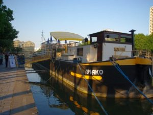 The Peniche Anako is a canal barge docked on the West Bank of the La Villette Basin in the 19th arrondissement.