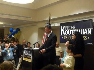 Sheriff Peter Koutoujian, his wife and children by his side, addressing supporters on primary night.