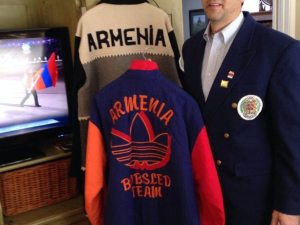Joe Almasian watches the Winter Olympics' opening ceremony with the two jackets he wore as Armenia's first athlete 20 years ago.