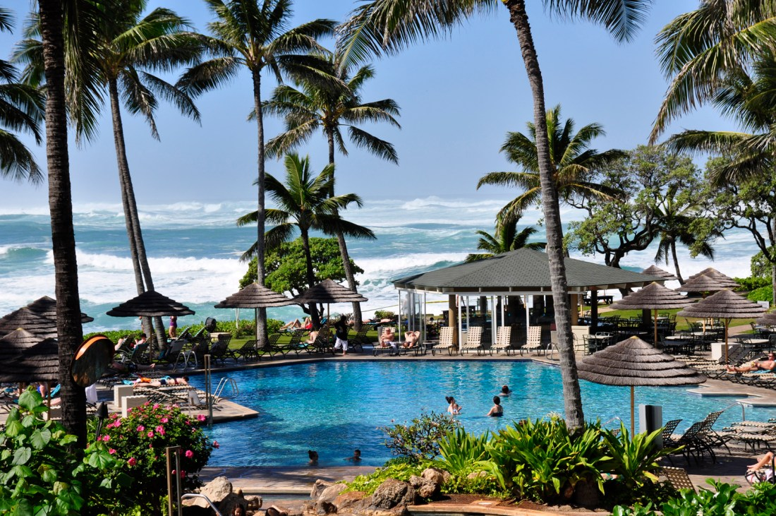 You can watch the incredible North Shore waves right from the comfort of the pool at Turtle Bay Resort. Credit: Curt Woodhall