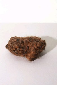 Richard Staub; Red Tress; hair pieces, thread; 2.25 x 4 x 7 inches; 2001