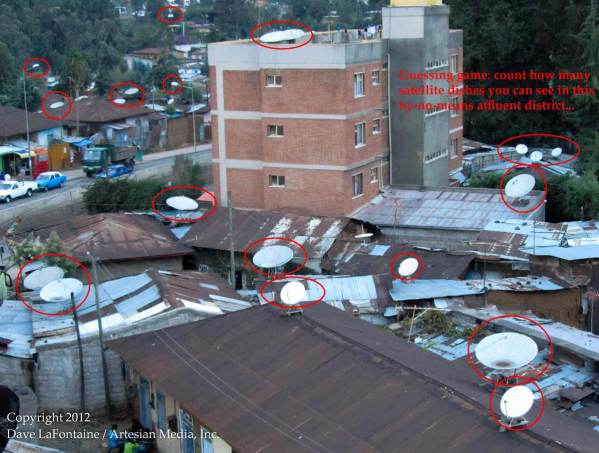 satellite dishes on the rooftops of humble abodes