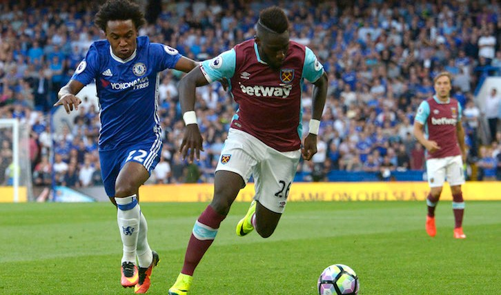 LONDON, ENGLAND - AUGUST 15:  Arthur Masuaku of West Ham United in action with Chelsea's Willian during the Premier League match between Chelsea and West Ham United at Stamford Bridge on August 15, 2016 in London, England.  (Photo by Arfa Griffiths/West Ham United via Getty Images)