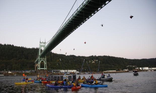 Activists dangle from bridge to stop icebreaker