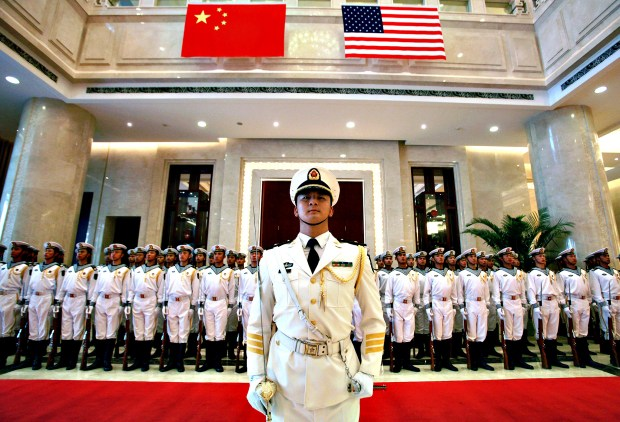 CNO Greenbert and his Chiinese counterpart Wu attend welcoming ceremony in Beijing...epa04316557 A military honor guard prepares for US Chief of Naval Operations Admiral Jonathan Greenert's visit with Commander in Chief of The People's Liberation Army (PLA) Navy Admiral Wu Shengli at a welcoming ceremony at the PLA Navy headquarters outside of Beijing, China, 15 July 2014.  For the first time since 1971 China's navy participated alongside the US navy in Rim of the Pacific naval exercises last week.  EPA/STEPHEN SHAVER / POOL