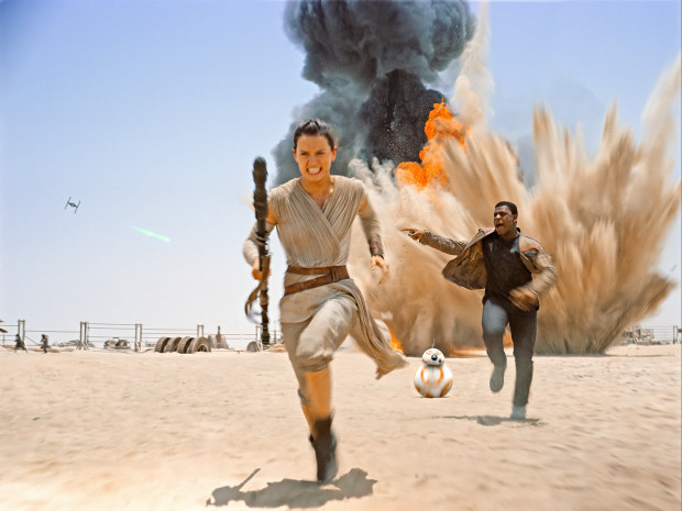 Rey runs from a Tie Fighter