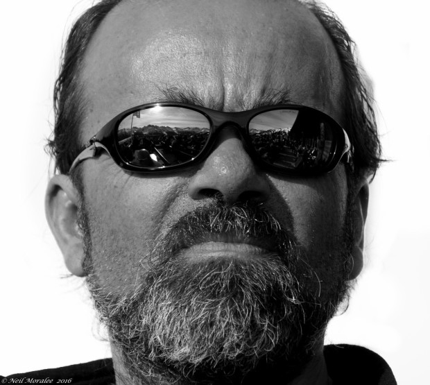 resting bitch face: angry looking bearded man with sunglasses
