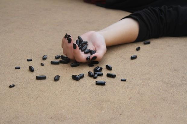 Ketamine for depression: black pills spilled out of a hand