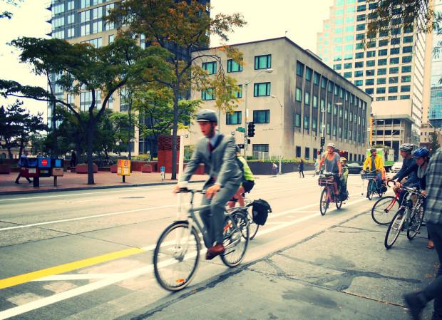 incentive to bike: Bikers in bike lanes commuting to work.