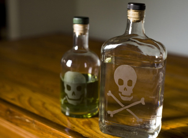 big oil: glass bottles with etched skull and crossbones, poison bottles