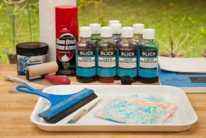 shaving cream, liquid watercolors, paper, tray, stick, squeegee, paper towels