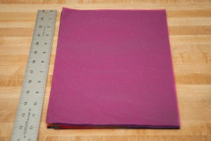 cut tissue paper to desired size, leaving room for folding top over string