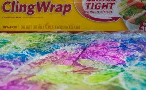layer pieces of crinkly plastic wrap on other areas of pooled colors