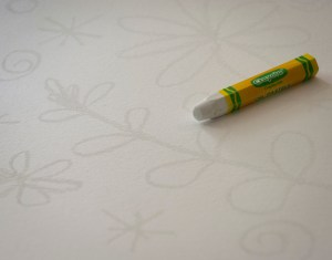 draw designs with a white crayon/ pastel