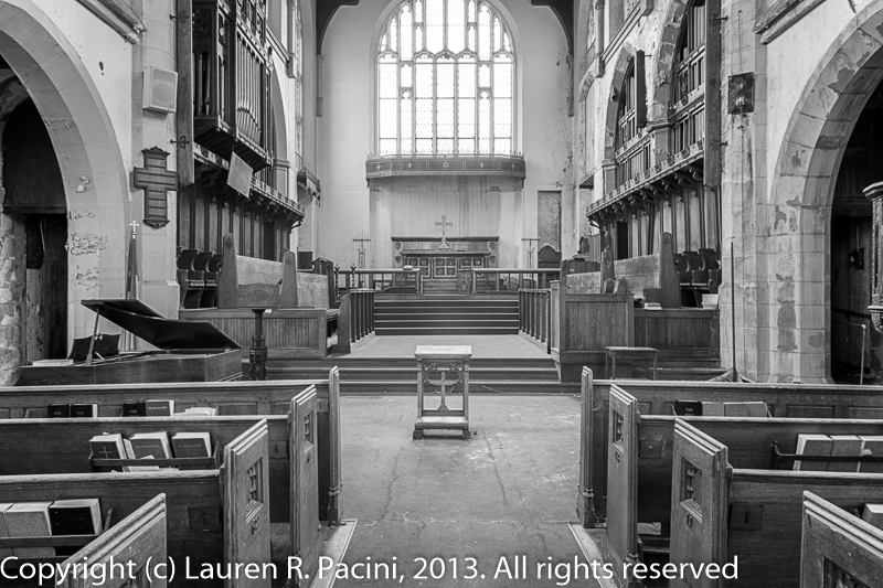 View of the Chancel with Kneeling Bench in the center. Piano and Lectern to the left; Pulpit to the right. Communion Table is out of view on the left.