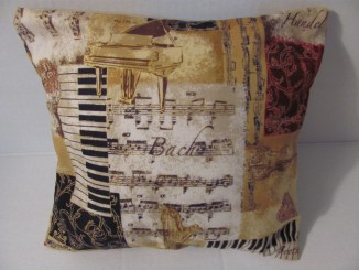 This elegant cotton pillow, with gold and burgundy accents, is available in standard and custom sizes. Bach and Handel lettering, along with images of a piano and keys, create a striking accent in your home, piano room or boutique.