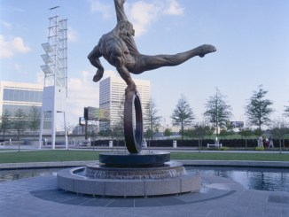 "Created for the 1996 Atlanta Olympics, ""Flair Across America - The Gymnast"" by sculptor Richard MacDonald is a celebration of the triumph of the human spirit - the dedication, tenacity and determination of every individual in the pursuit of excellence. ""Flair Across America"" is a the 26-foot high heroic bronze monument that resides permanently at Georgia International Plaza in Atlanta, Georgia. (PRNewsFoto/Richard MacDonald Studios, Inc.)"