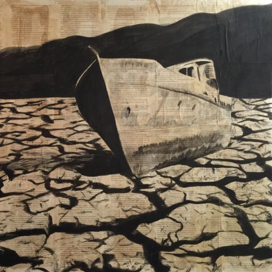 boat stranded on dry, cracked lake bed