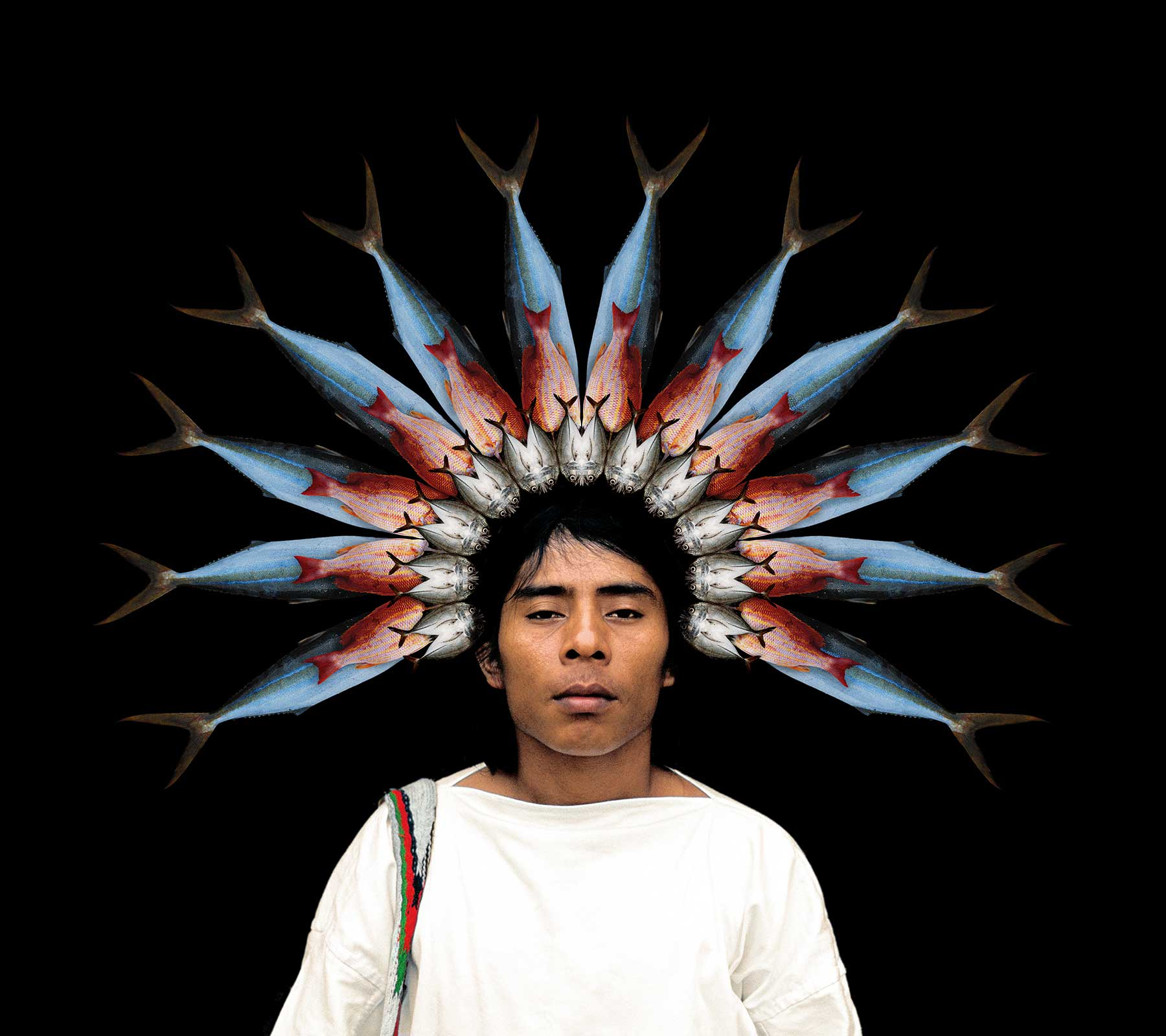 indigenous man with crown of fish