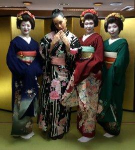 Katy Perry poses with Geishas