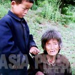 An old woman and her ten-year-old grandson, who live in the mountains to avoid being thrown into Kotchebi detention camps. They say the boy's mother went to sell her wares, and never came back.(June 2011, suburbs of Pyongyang City by Gu Gwang-ho) ASIAPRESS