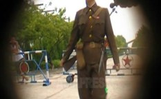 "In South Pyongan Province, a female security officer is working at a military facility inside a large-scale factory.  She carries a gun with a bayonet.  She may be a member of the ""Worker-Peasant Red Guards"" since she does not have a military arm-band.  August 2009, taken by Kim Dong-cheol (ASIARESS)"