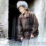 """A grandmother and her grandson, after being kicked out by her son-in-law because he couldn't afford to feed them anymore, lived in an old air raid shelter in a suburb of Pyongyang.  She told an ASIAPRESS reporting partner in North Korea, """"The state authority would have me detained if I get caught in a city.""""  June 2011, in a suburb of Pyongyang.  Taken by Koo Gwang-ho (ASIAPRESS)"""