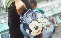 A mother is holding a Mickey Mouth bag for a child.  In recent few years, various kinds of Mickey Mouse products spread in North Korea.  August 2013, in Hyesan, Ryanggang Province.  Taken by our Team 'Mindeulle' (ASIAPRESS)