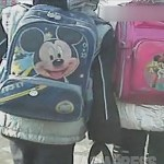 Primary school students with Mickey Mouse school bag.  November 2012, in Sinuiju, North Pyongan Province.  Taken by ASIAPRESS.