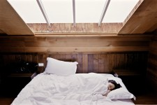 woman sleeping in a white bed