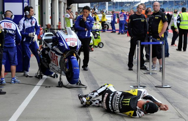 Caption This Photo: Stop, Drop, & Roll Colin Edwards Fiat Yamaha Jorge Lorenzo British GP 635x411