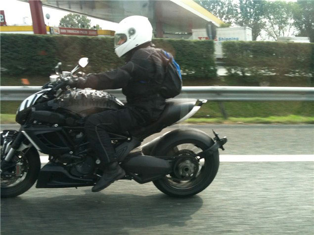 Spy Shots: Ducati Diavel Gets A Little Bit More Refined   No Pillion Available? 2011 Ducati Diavel spy shot side 623x467
